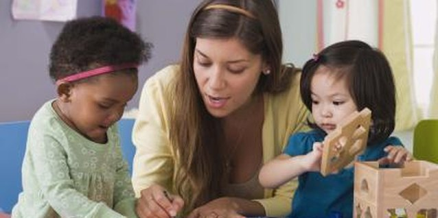 Nursery school teachers help young children prepare for kindergarten.