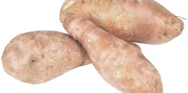 The sweet potato's deep orange hue reveals its rich beta-carotene content.