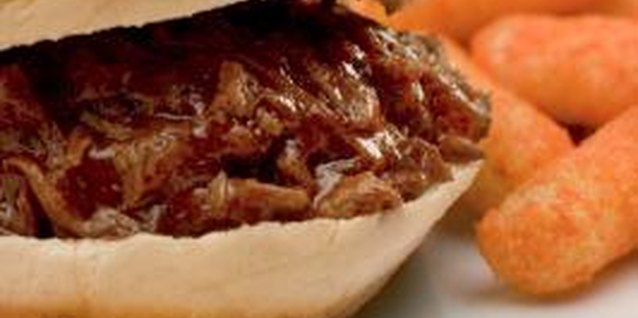 Serve the shredded pork on a soft bun for a traditional summer sandwich.
