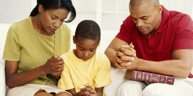 Help your child understand how to talk to God by praying with him.
