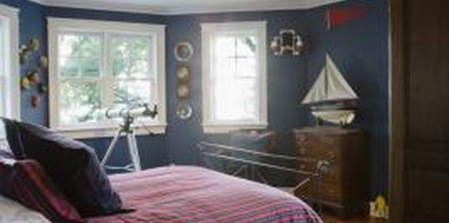 Blue walls and a model sailboat equal an instant seafaring theme.