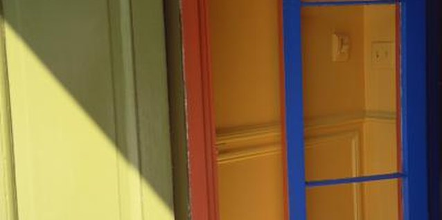 Spice up white walls by adding colors to interior door frames.