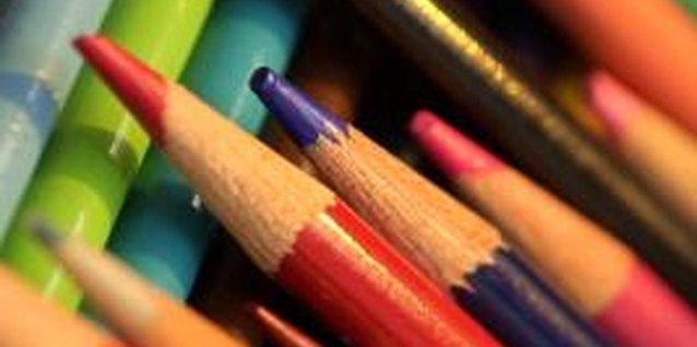 Use colored pencils to help your preschooler learn how to write.