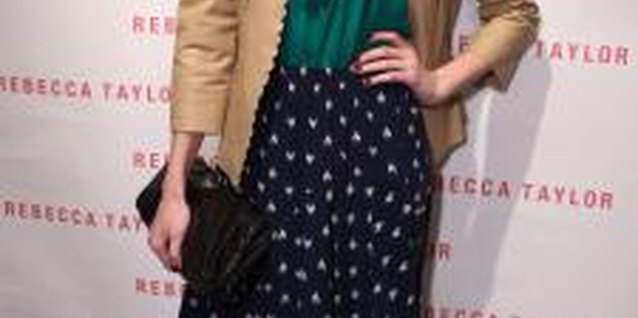 Emma Robert sports a blue-dotted skirt at a store opening in Los Angeles.