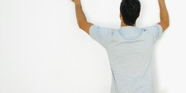 How to Paint Stripes on a Wall Without Leaking Through the Tape