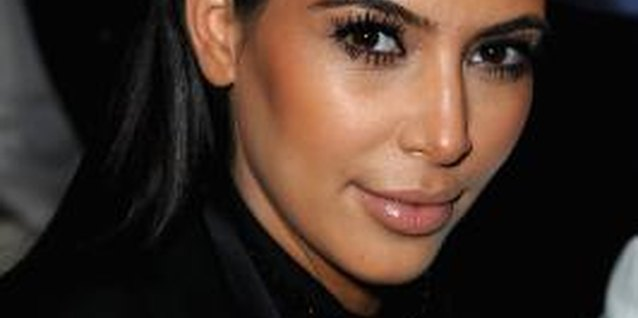 Kim Kardashian sports sculpted eyebrows at the Givenchy Fall/Winter Ready-to-Wear show in Paris.