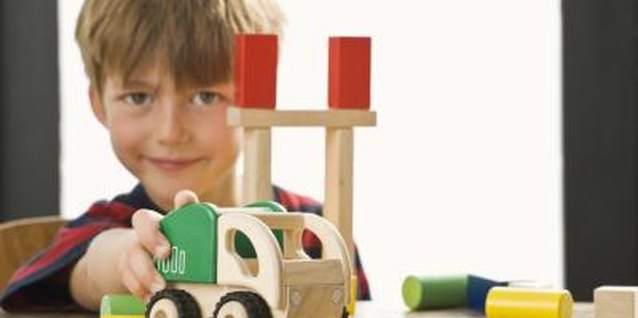 Children with autism might play with toys in a repetitive manner.