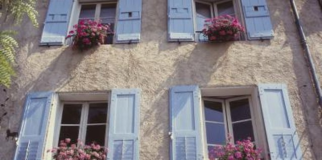 Windows in the French countryside are often adorned with flowerboxes overflowing with lush blooms.
