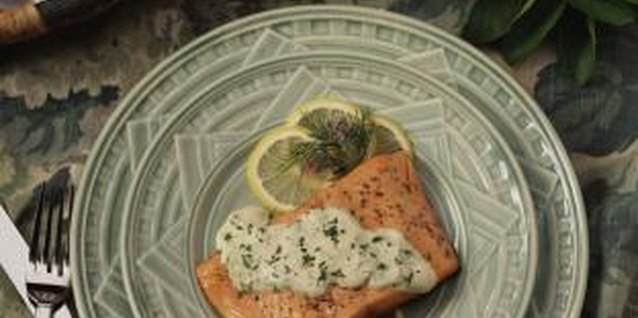Spread a dill yogurt sauce on top of salmon for baking.