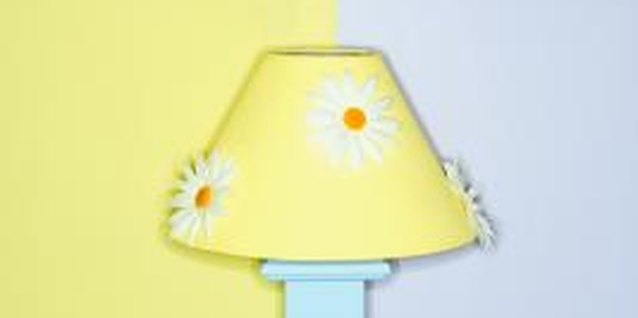 Bright-colored paint and decorative appliques add zing to a lackluster lampshade.