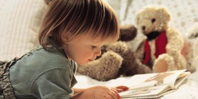 Toddlers often pretend to read their favorite books.