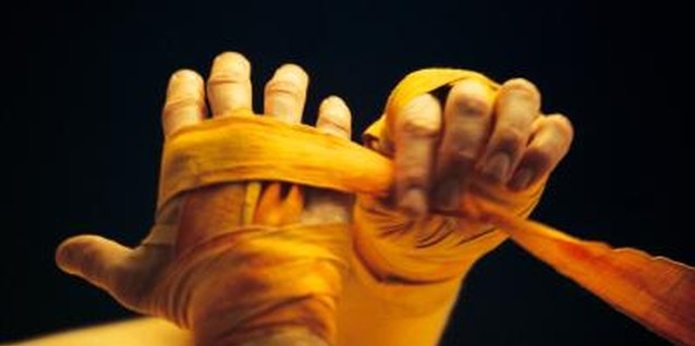 During training, boxers typically wrap their hands with cotton wraps.