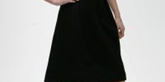 A knee-length high-waist black skirt with a button-down creates a sophisticated style.