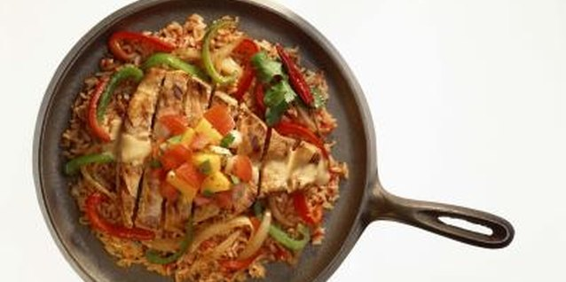 Bake a frozen halibut filet and vegetables in a cast-iron skillet.