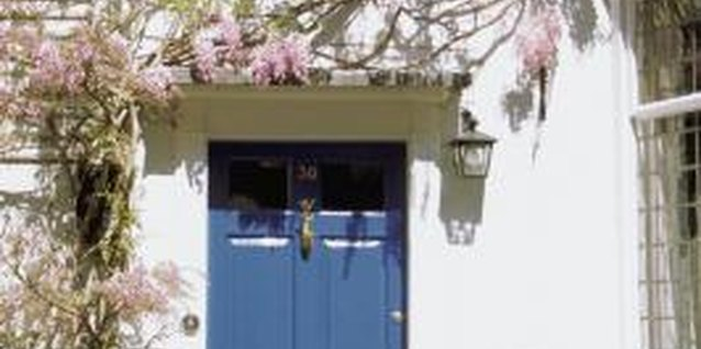 With a neutral-color exterior, you can make a statement by using bright blue or green for your front door.