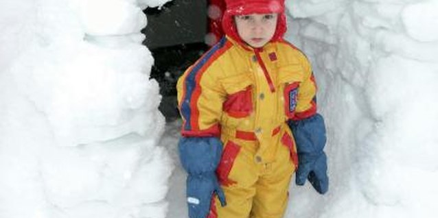 Keep his gloves in place so he can get back to his snow fort building.