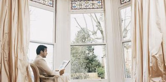 Maximize the view from your bay window with operable drapery treatments.