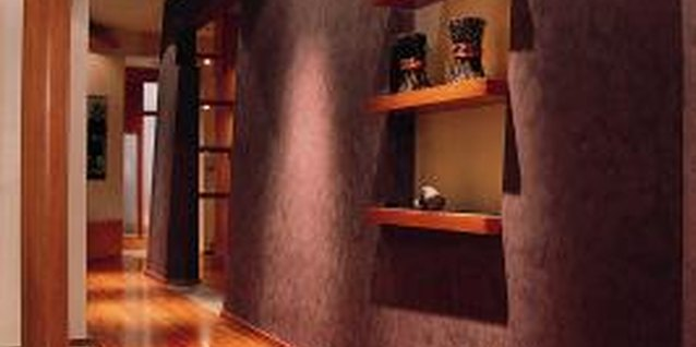 Choose a stacked design or a free-form arrangement of picture ledges to decorate a long hallway.