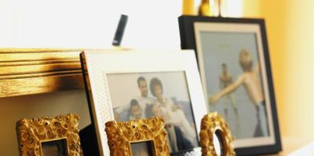 Display personal photos artfully on a fireplace mantel.
