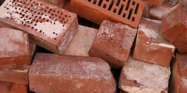 Creatively decorate old bricks before using them as decor in or around your home.
