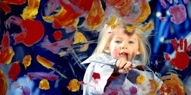 Finger painting brings out the creativity in kids.