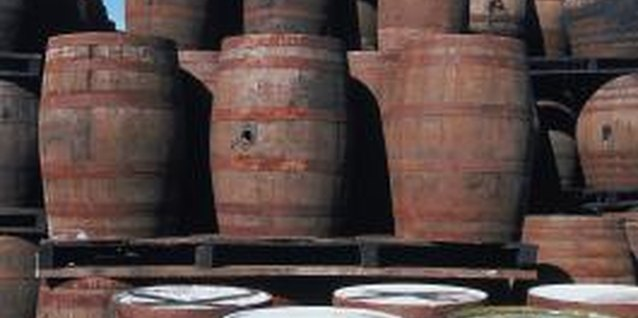 Old whiskey barrels are often cut in half for use in the garden.