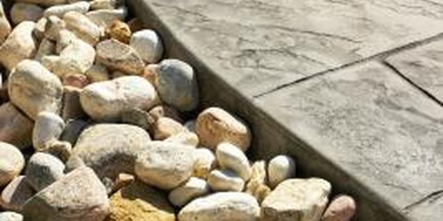 If the rocks are only hand-sized, use a wheelbarrow to move them.