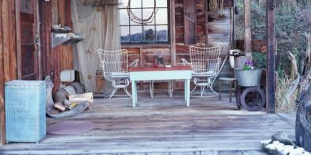 Antique finds serve as functional decor for a log cabin porch.