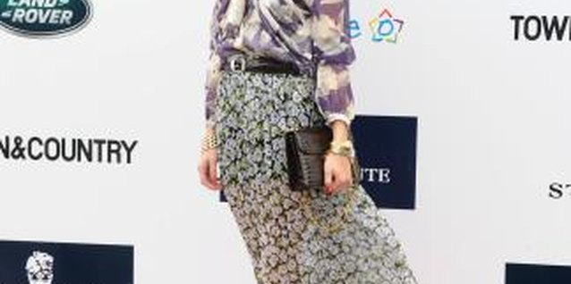 Olivia Palermo pairs her floral skirt with a printed blouse.