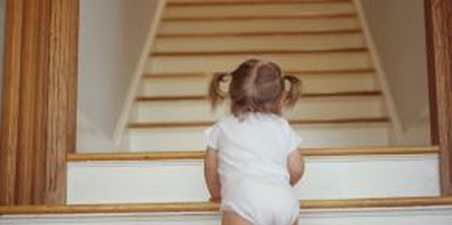 Keep toddlers from climbing stairs by giving them safe things to practice climbing on.