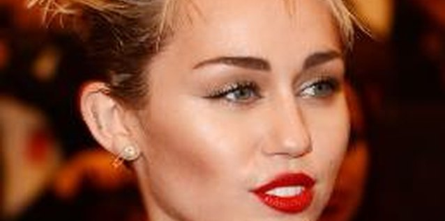 Singer Miley Cyrus became a punk-rock style icon after she cut her hair short.