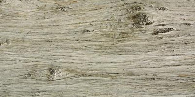 The weathered wood effect includes pock-marks and raised grain.