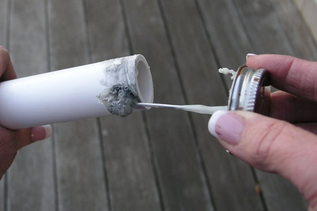 Apply the glue around the tube.