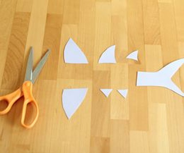 Cut the shark's fins and tail out of cardstock.