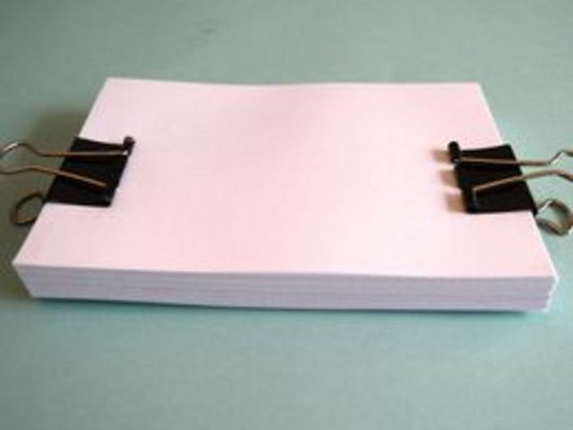 Use binder clips to secure pages.