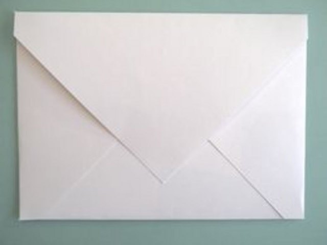 Use a glue stick to seal the envelope.