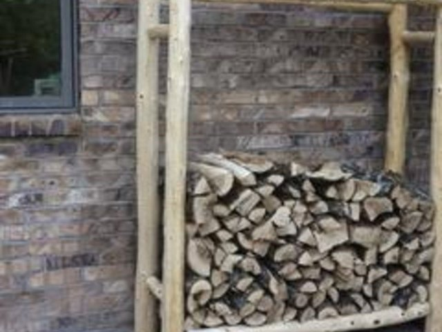 Firewood stored off the ground seasons faster and shelters fewer pests.