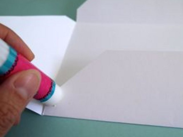 Use a glue stick to secure the bottom of the envelope.
