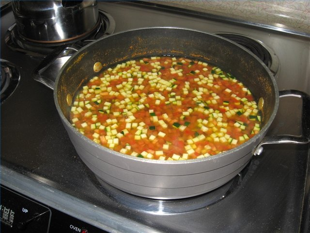 Chana cooking with tomato, zucchini