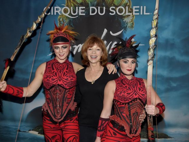 Members of Cirque du Soleil doing promotion.