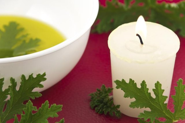Citronella oil with candle and leaves.