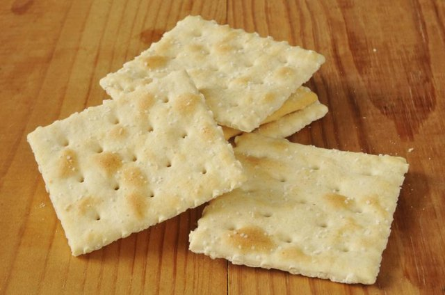 Saltine crackers on tabletop.