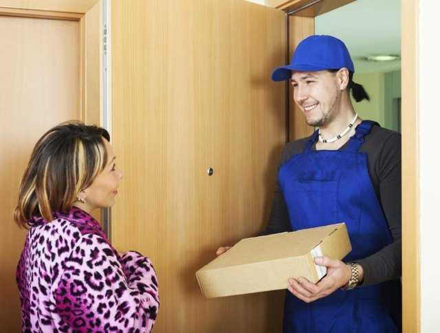 Image of a delivery man giving a woman a package.