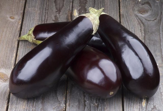 Eggplants on table.