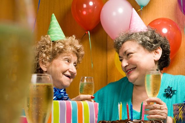 Senior citizens drinking champagne at a party.