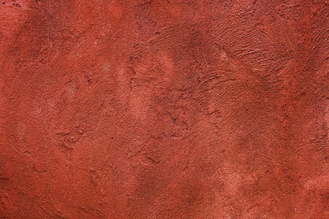 A close-up of a brick red textured wall.