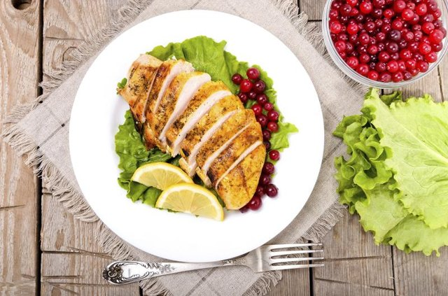Cooked chicken breast with cranberries and lettuce