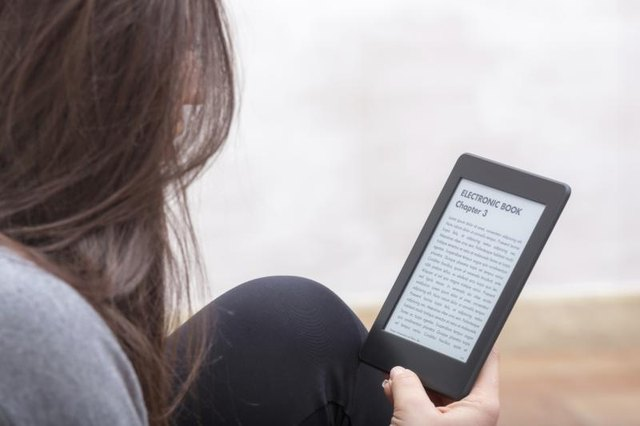 Image of a woman reading an electronic book.