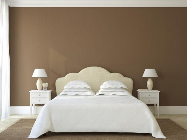 Bedroom with warm umber walls.