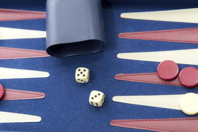 Dice on a backgammon board.
